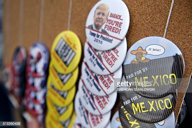 Campaign buttons for sale outside a rally for Republican presidential hopeful Donald Trump March 13 2016 in West Chester Ohio / AFP / Brendan...