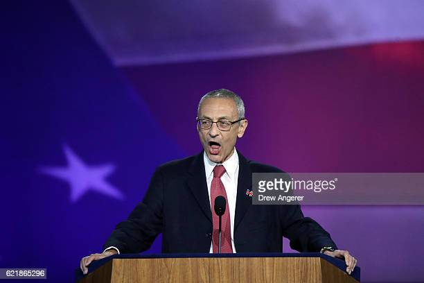 Campaign chairman John Podesta announces on stage that Democratic presidential nominee former Secretary of State Hillary Clinton will not speak on...