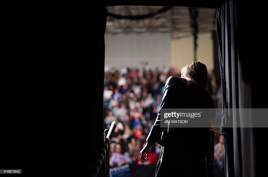 Campaign Communications Manager Hope Hicks looks out from back stage as Republican presidential candidate Donald Trump speaks to supporters during a campaign rally in Sumter, South Carolina, February 17, 2016. / AFP / JIM