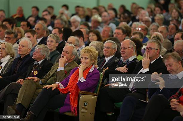 UKIP campaign director Neil Hamilton and his wife Christine listen as UK Independence Party leader Nigel Farage speaks at The Forum in Bath on April...