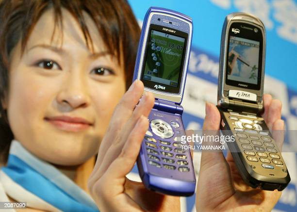 A campaign girl of leading Japanese mobile phone carrier NTT DoCoMo Inc presents its new series of the thirdgeneration FOMA F2102V and N2102V...