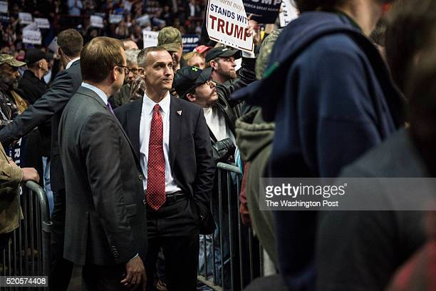 Campaign manager Corey Lewandowski center listens as republican presidential candidate Donald Trump speaks during a campaign event at the Times Union...