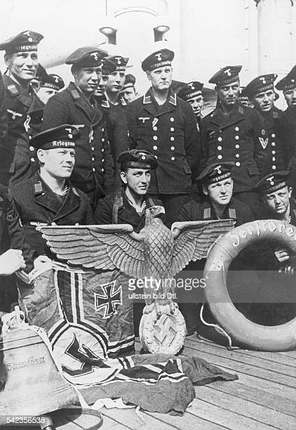 2 WW campaign of Denmark_Norway from on Norway Combat for narvik 0904The crew of one of the sunken destroyers at Narvik with saved insignia of their...