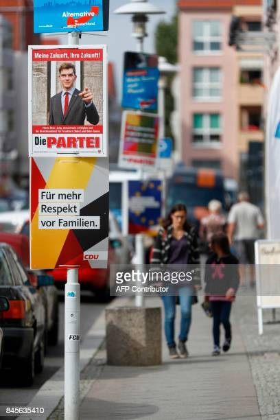 Campaign placards of the Christian Democratic Union of Gaulands challengers in Wahlkreis 63 and youngest candidate for upcoming general elections...