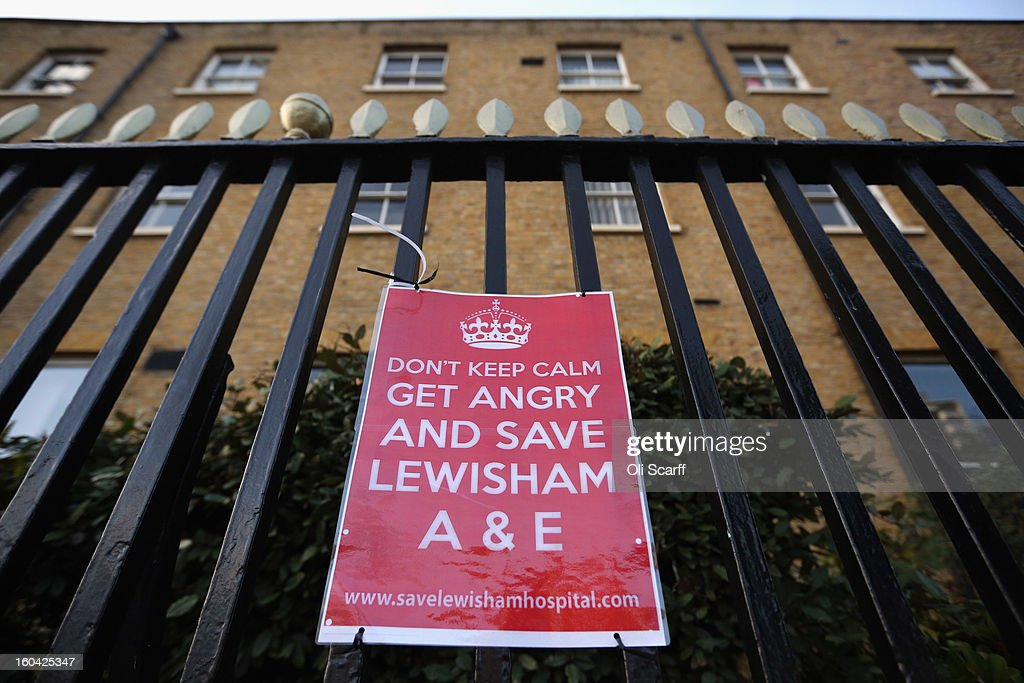 A campaign poster attached to the railings of Lewisham Hospital's A&E department which is to be downgraded and reduced in size as part of cost-cutting measures on January 31, 2013 in London, England. Health Secretary Jeremy Hunt today announced the cuts to Lewisham's Accident and Emergency and Maternity units in a bid to reduce debts of 150 million GBP held by the neighbouring South London Healthcare NHS Trust. Over 15,000 people had attended a protest march against the cuts on January 26, 2013.