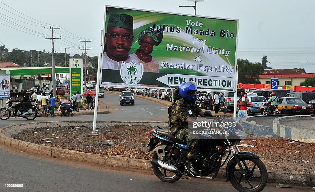 A campaign poster of Sierra Loene people party (SLPP) candidate for November 17 presidential election Juluis Maada Bio is pictured in a street of Freetown, on November 14, 2012 . AFP PHOTO / ISSOUF SANOGO