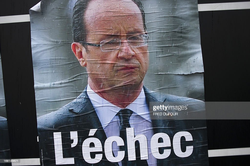 A campaign poster of the French right wing opposition party UMP showing French President Francois Hollande and reading 'L'Echec' ('The failure') is pictured in a street of Paris in May 6, 2013. When he swept to power last May on a wave of discontent, Francois Hollande could hardly have imagined that a year later he would be the most unpopular president in modern French history.