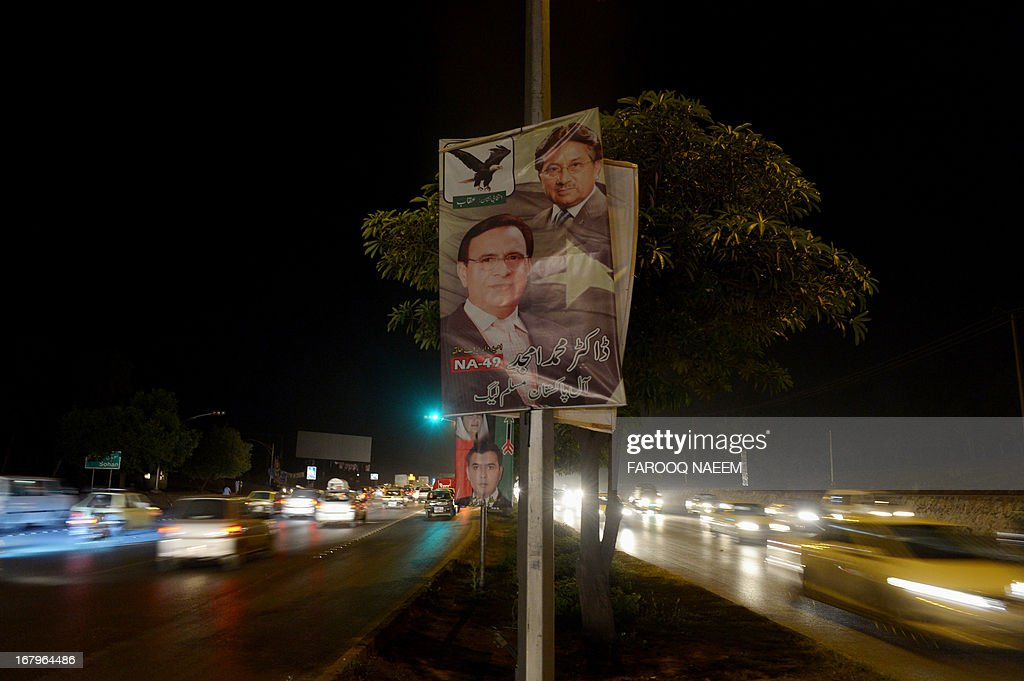 A campaign poster the party of former Pakistani military ruler Pervez Musharraf, who is facing a barrage of legal cases over his time in power, is pictured on a street in Islamabad on May 3, 2013, as the party announced today it will boycott next week's historic election. The retired general has been humiliated since returning in March from self-imposed exile to contest elections and is currently under house arrest. AFP PHOTO/Farooq NAEEM