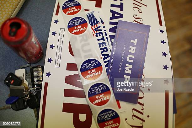 Campaign posters and stickers are seen as volunteers call voters asking them to vote for Republican presidential candidate Donald Trump while working...