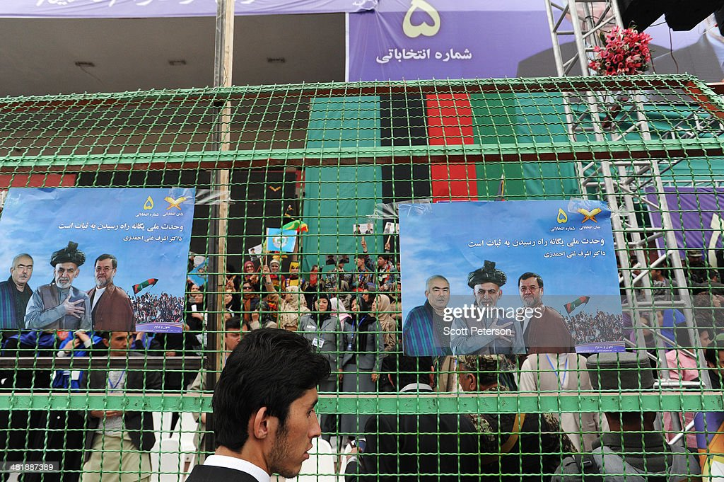Campaign posters are taped to a security fence as Afghan Presidential Candidate Ashraf Ghani Ahmadzai holds a rally for thousands of supporters at the Ghazi stadium on April 1, 2014 in Kabul, Afghanistan. Mr. Ghani is a frontrunner in the April 5 vote to succeed President Hamid Karzai, in an election that is seen as a test of stability that will ensure continued Western donor aid for a nation torn by a Taliban insurgency. The Ghazi stadium is known as the site of amputations and executions during Taliban rule in the late 1990s.