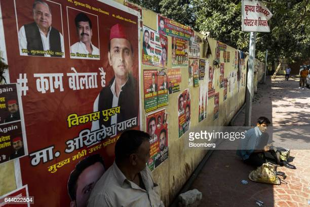 Campaign posters featuring images Akhilesh Yadav chief minister of the state of Uttar Pradesh and president of the Samajwadi Party third from left...