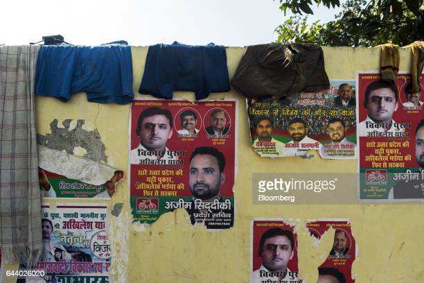 Campaign posters featuring images Akhilesh Yadav chief minister of the state of Uttar Pradesh and president of the Samajwadi Party are displayed on a...