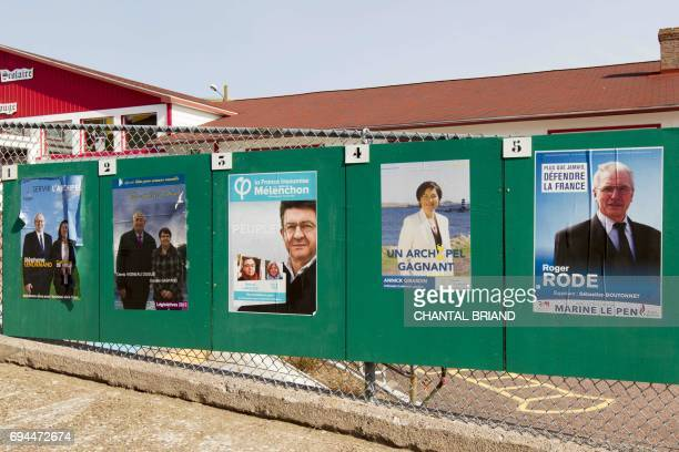 Campaign posters for the French legislative elections are displayed outside a polling station in the French overseas territory of SaintPierre on June...