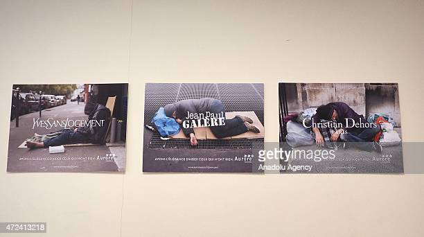 Campaign posters of a fashion icons' project aiming to help homeless people are seen in Paris France on May 6 2015 A hardhitting poster campaign in...