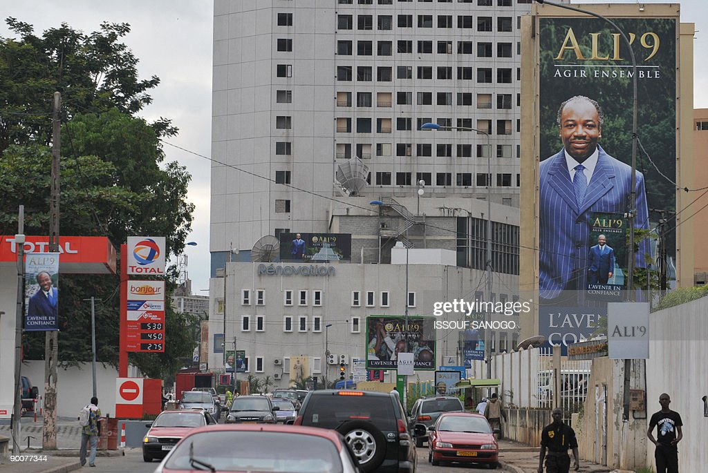 Campaign posters of Ali Bongo Ondimba the son of the late president Omar Bongo Ondimba are pictured on a main street in Liberville on August 25...