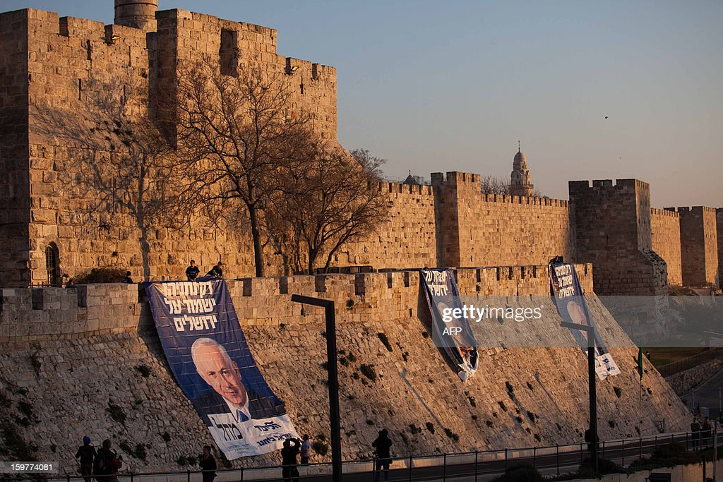 Campaign posters of Israeli Prime Minister and Likud party leader Benjamin Netanyahu, with text reading in Hebrew: ' Only Netanyahu will guard Jerusalem' are seen under David's Citadel at Jaffa Gate in the old city of Jerusalem on January 20, 2013, ahead of the Israeli general election on January 22. == ISRAEL