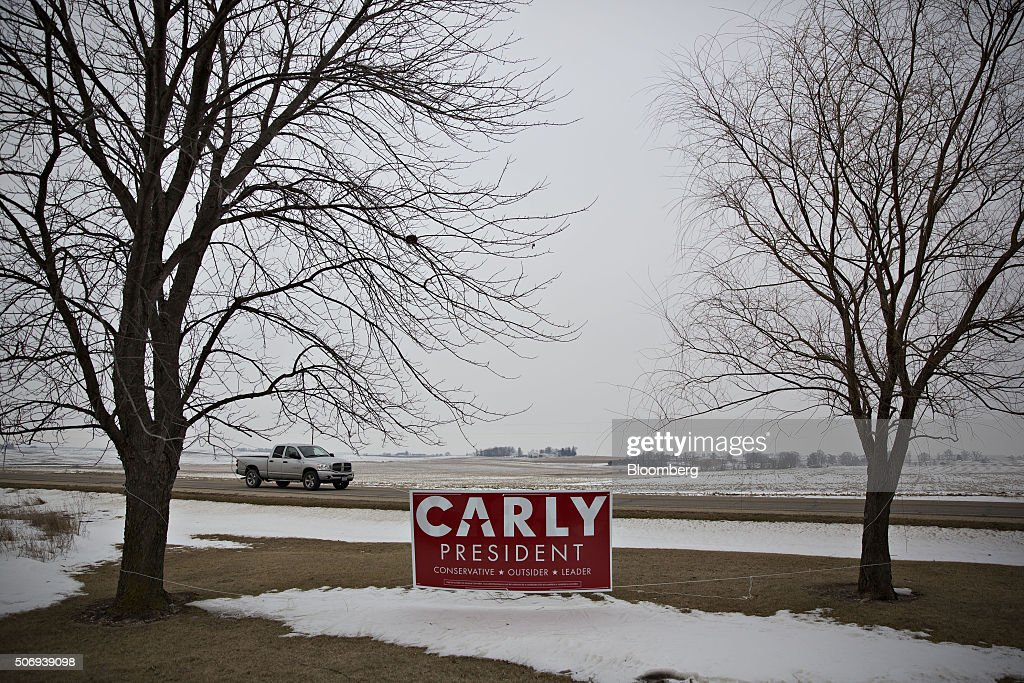 A campaign sign for Carly Fiorina former chairman and chief executive officer of HewlettPackard Co and 2016 Republican presidential candidate hangs...