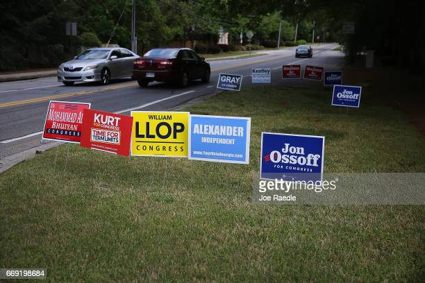 A campaign sign for Democratic candidate Jon Ossoff is seen among other candidates' signs as he runs for Georgia's 6th Congressional District in a...