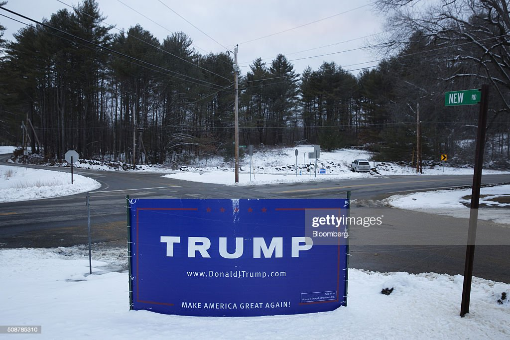 A campaign sign for Donald Trump, president and chief executive of Trump Organization Inc. and 2016 Republican presidential candidate, sits at a cross roads in Canterbury, New Hampshire, U.S., on Saturday, Feb. 6, 2016. On Tuesday, voters in New Hampshire will cast their ballots in the nation's first political primary of the election season. Photographer: Victor J. Blue/Bloomberg via Getty ImagesA