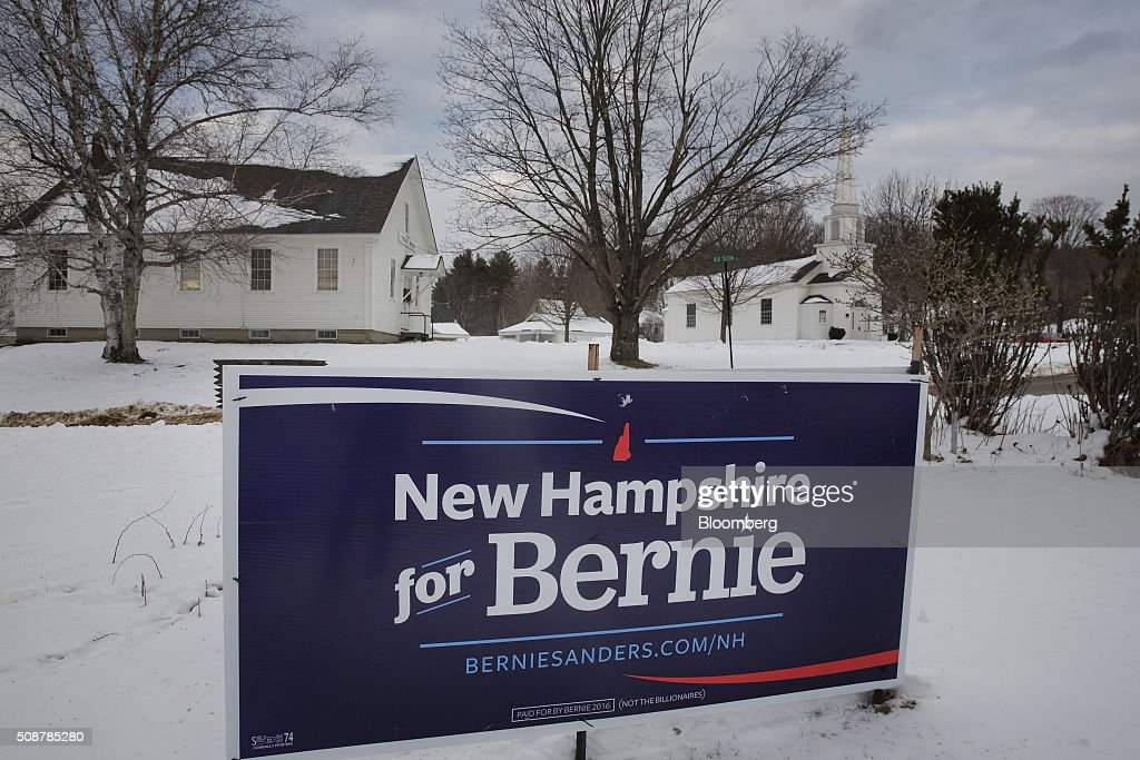 A campaign sign for Senator Bernie Sanders, an independent from Vermont and 2016 Democratic presidential candidate, sits at a cross roads outside of Canterbury, New Hampshire, on Saturday, Feb. 6, 2016. On Tuesday, voters in New Hampshire will cast their ballots in the nation's first political primary of the election season. Photographer: Victor J. Blue/Bloomberg via Getty Images