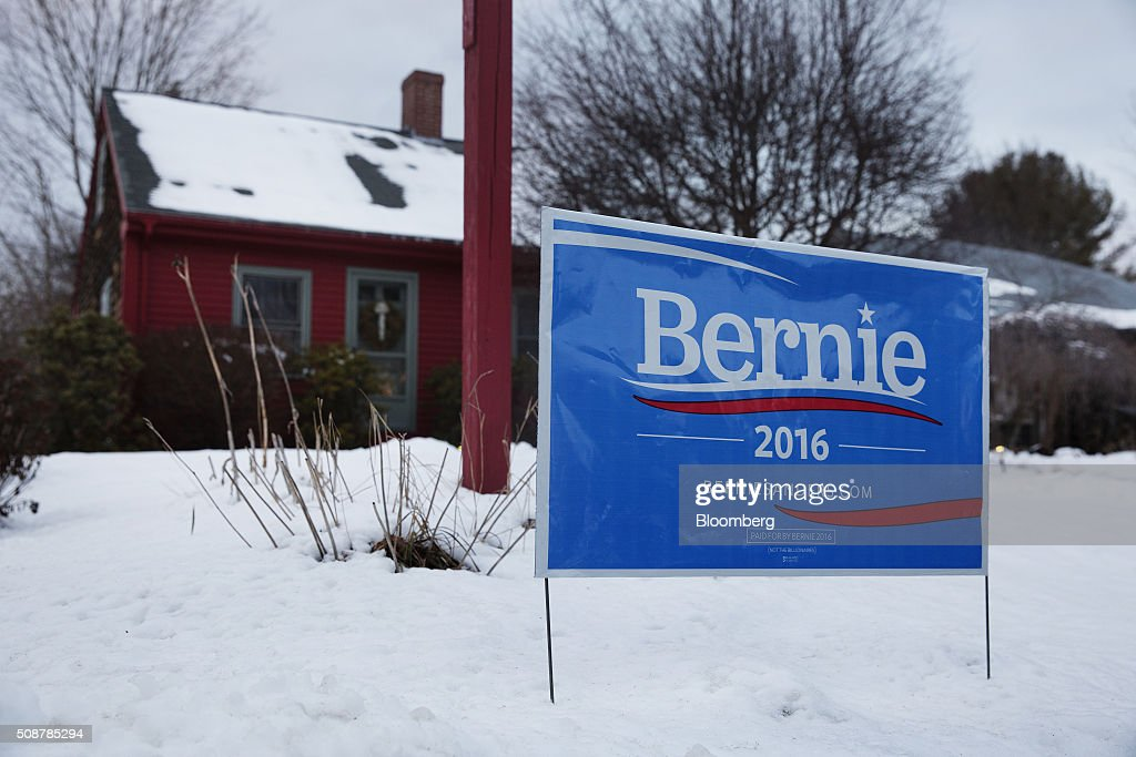 A campaign sign for Senator Bernie Sanders, an independent from Vermont and 2016 Democratic presidential candidate, sits outside a home in Canterbury, New Hampshire, on Saturday, Feb. 6, 2016. On Tuesday, voters in New Hampshire will cast their ballots in the nation's first political primary of the election season. Photographer: Victor J. Blue/Bloomberg via Getty ImagesA