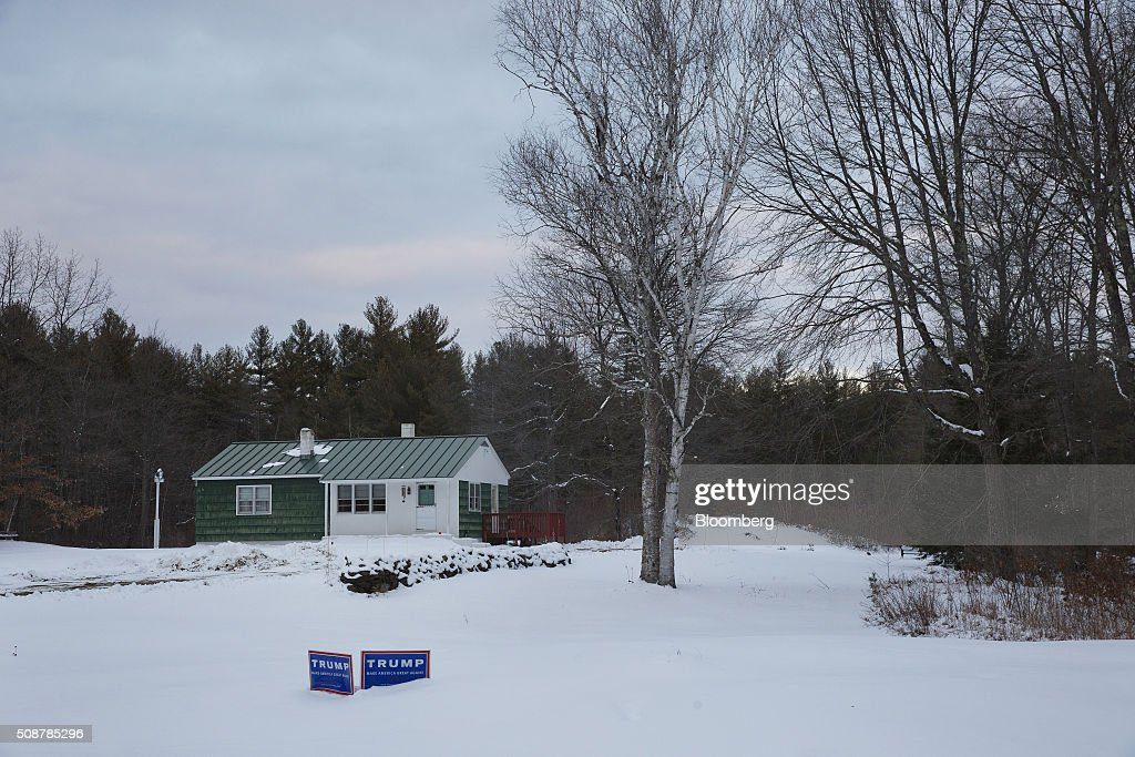 Campaign signs for Donald Trump, president and chief executive of Trump Organization Inc. and 2016 Republican presidential candidate, sit outside a home in Canterbury, New Hampshire, U.S., on Saturday, Feb. 6, 2016. On Tuesday, voters in New Hampshire will cast their ballots in the nation's first political primary of the election season. Photographer: Victor J. Blue/Bloomberg via Getty Images