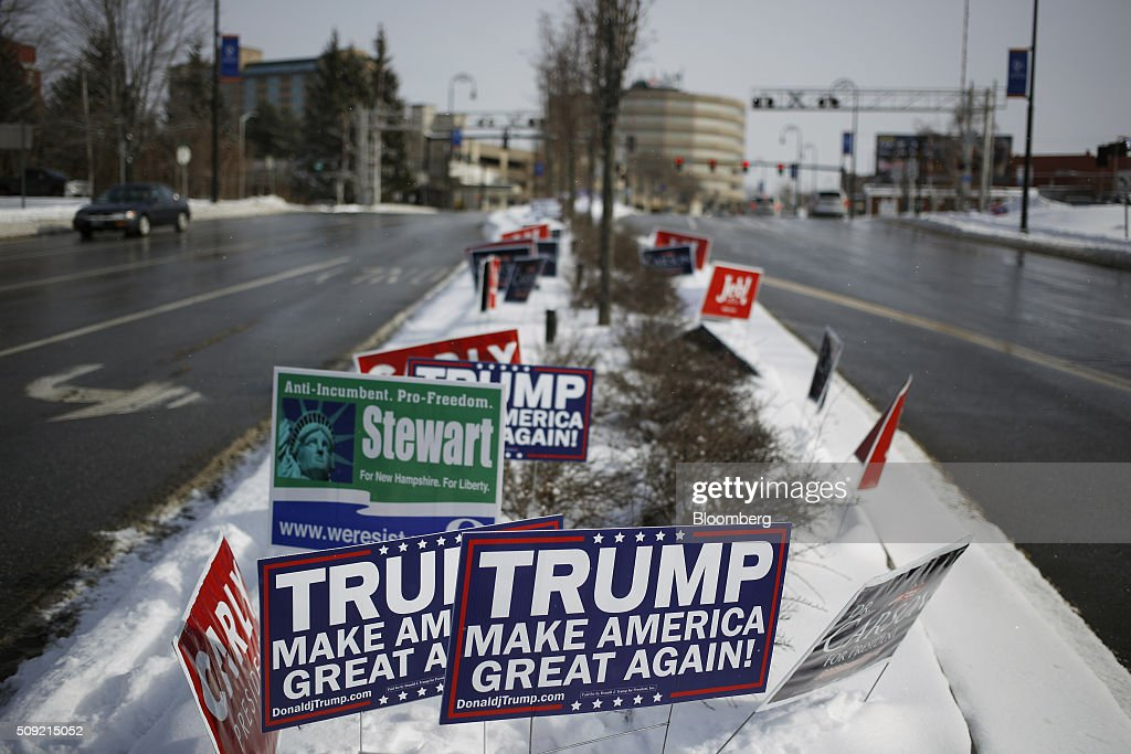 Campaign signs for Donald Trump, president and chief executive of Trump Organization Inc. and 2016 Republican presidential candidate, are displayed at an intersection in downtown Manchester, New Hampshire, U.S., on Tuesday, Feb. 9, 2016. Voters in New Hampshire took to the polls today in the nation's first primary in the U.S. presidential race. Photographer: Luke Sharrett/Bloomberg via Getty Images