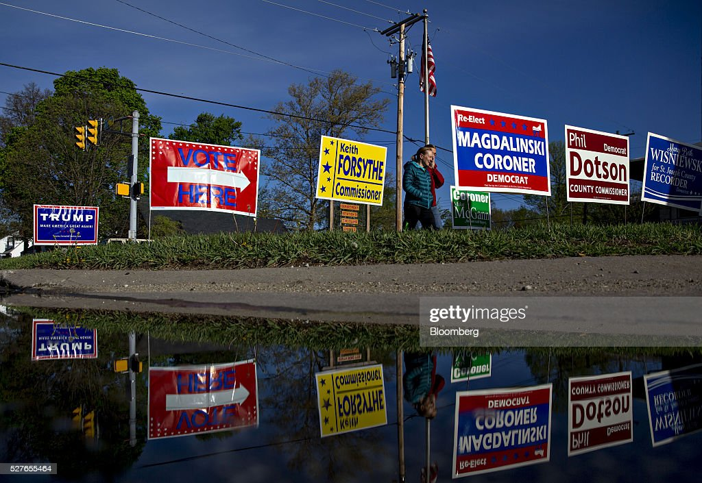 Campaign signs stand outside a polling station during the presidential primary vote in South Bend, Indiana, U.S., on Tuesday, May 3, 2016. The outcome in Indiana, where balloting across two time zones will end at 7 p.m. Eastern time, could yield a deciding moment as the presidential race enters the home stretch. Photographer: Daniel Acker/Bloomberg via Getty Images