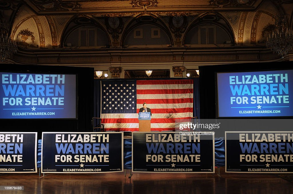 A campaign staffer performs a mike check at Elizabeth Warren headquarters at the Copley Fairmont Hotel November 6, 2012 Boston, Massachusetts. Warren is in a deadlocked tie with U.S. Senator Scott Brown. Photo by Darren McCollester/Getty Images)