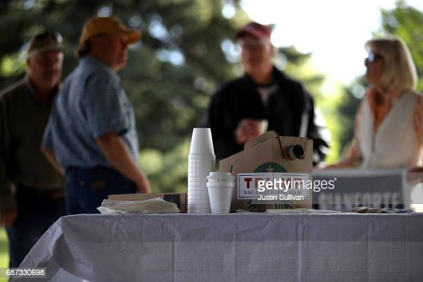 A campaign sticker for US President Donald Trump is displayed on a container of coffee during a campaign meet and greet with Republican congressional...