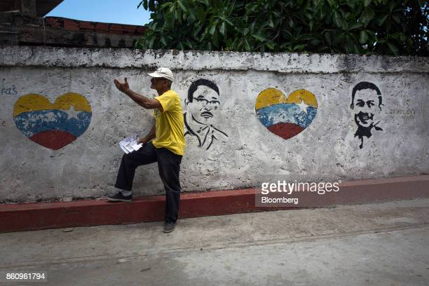 A campaign volunteer hands out pamphlets for Jose Manuel Olivares opposition coalition governor candidate for Vargas State in La Guaira Venezuela on...