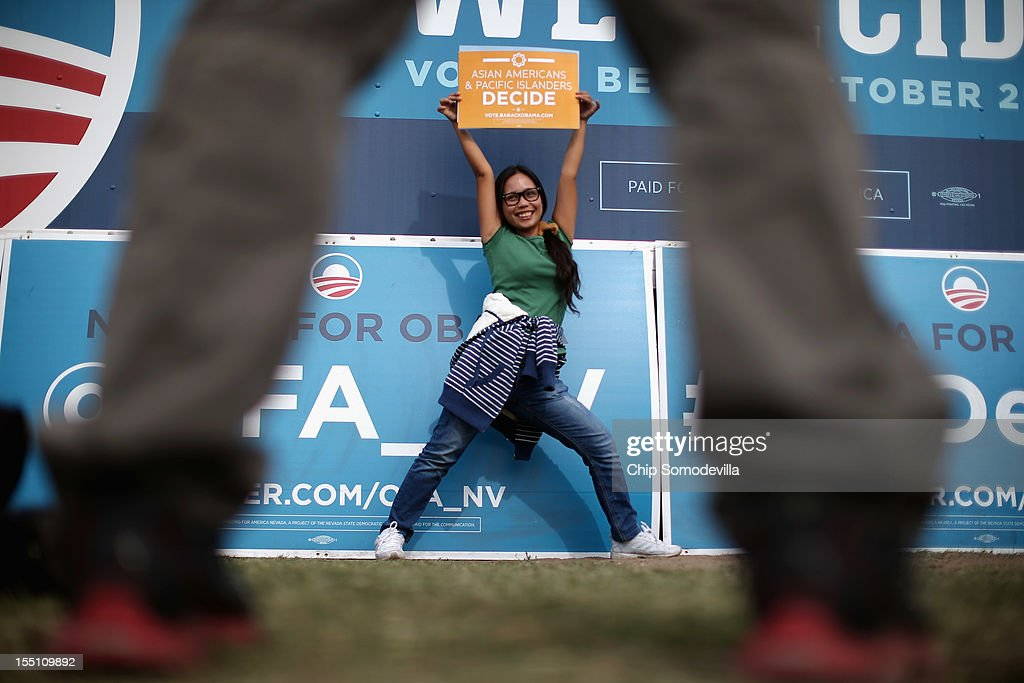 Campaign volunteers ask supporters to pose for photographs with campaign signs before a rally with U.S. President <a gi-track='captionPersonalityLinkClicked' href=/galleries/search?phrase=Barack+Obama&family=editorial&specificpeople=203260 ng-click='$event.stopPropagation()'>Barack Obama</a> on the campus of the College of Southern Nevada November 1, 2012 in North Las Vegas, Nevada. With five days remaining in the presidential campaign, Obama travels today to Wisconsin, Colorado and Nevada after spending the last four days leading the federal government's response to Superstorm Sandy.