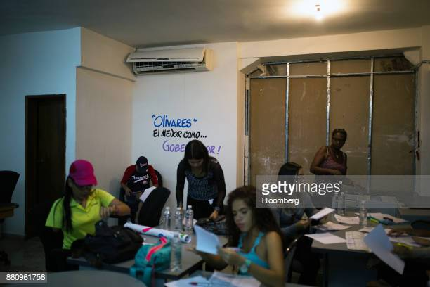 Campaign volunteers for Jose Manuel Olivares opposition coalition governor candidate for Vargas State work in a temporary office in La Guaira...