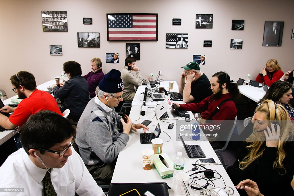 Campaign volunteers for Republican presidential candidate Donald Trump make phone calls to New Hampshire voters at Trump's campaign office on February 9, 2016 in Manchester, New Hampshire. Voters throughout the state are heading to the polls as the New Hampshire Primary, also known as the first-in-the-nation primary, continues the process of selecting the next president of the United States.