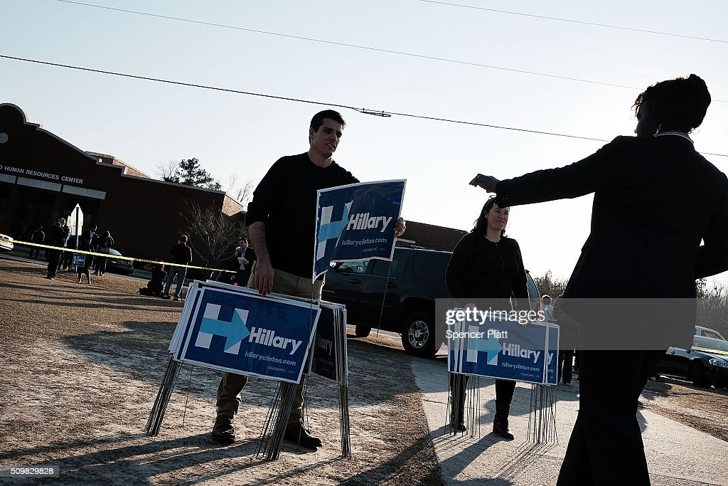 Campaign workers pass out signs following an appearance by Democratic presidential candidate Hillary Clinton in South Carolina a day after her debate with rival candidate Sen. Bernie Sanders (D-VT) on February 12, 2016 in Denmark, South Carolina. Clinton is counting on strong support from the African American community in South Carolina to give her a win over Sanders in the upcoming primary on February 27.