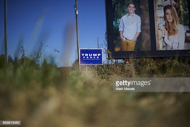 A campaign yard sign is displayed in front of a billboard near the site of a rally with Republican Presidential nominee Donald J Trump November 4...