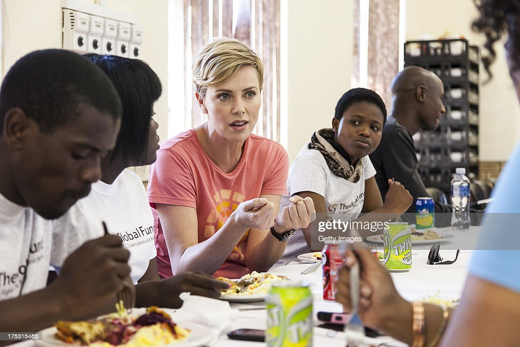 AIDS campaigner and actress <a gi-track='captionPersonalityLinkClicked' href=/galleries/search?phrase=Charlize+Theron&family=editorial&specificpeople=171250 ng-click='$event.stopPropagation()'>Charlize Theron</a> visits a Youth Ambassador Project funded by the Global Fund to Fight AIDS, Tuberculosis & Malaria at the Malangeni Thusong Centre, on August 2, 2013 in the Ugu district of KwaZulu Natal, South Africa. <a gi-track='captionPersonalityLinkClicked' href=/galleries/search?phrase=Charlize+Theron&family=editorial&specificpeople=171250 ng-click='$event.stopPropagation()'>Charlize Theron</a> spoke with beneficiaries of the Youth Ambassador Program, joined group discussions and refereed a soccer match between ambassadors and beneficiaries of the project to help prevent the spread of HIV. The program, supported by the Global Fund to Fight AIDS, Tuberculosis and Malaria, trains young men and women in KwaZulu Natal province to disseminate HIV prevention messages by engaging with youth in schools, support groups, churches, at sport events and in their homes.