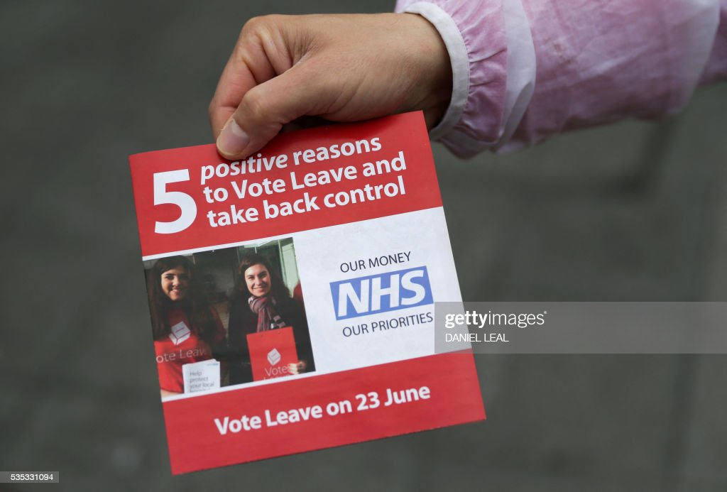 A campaigner for 'Vote Leave', the official 'Leave' campaign organisation for the forthcoming EU referendum, hands out leaflets outside Wembley Park tube station in north west London on May 29, 2016. Politicians and world leaders have dominated the headlines in the campaign for Britain's EU referendum, but a passionate battle for the country's future is also being fought by activists on the streets. / AFP / DANIEL