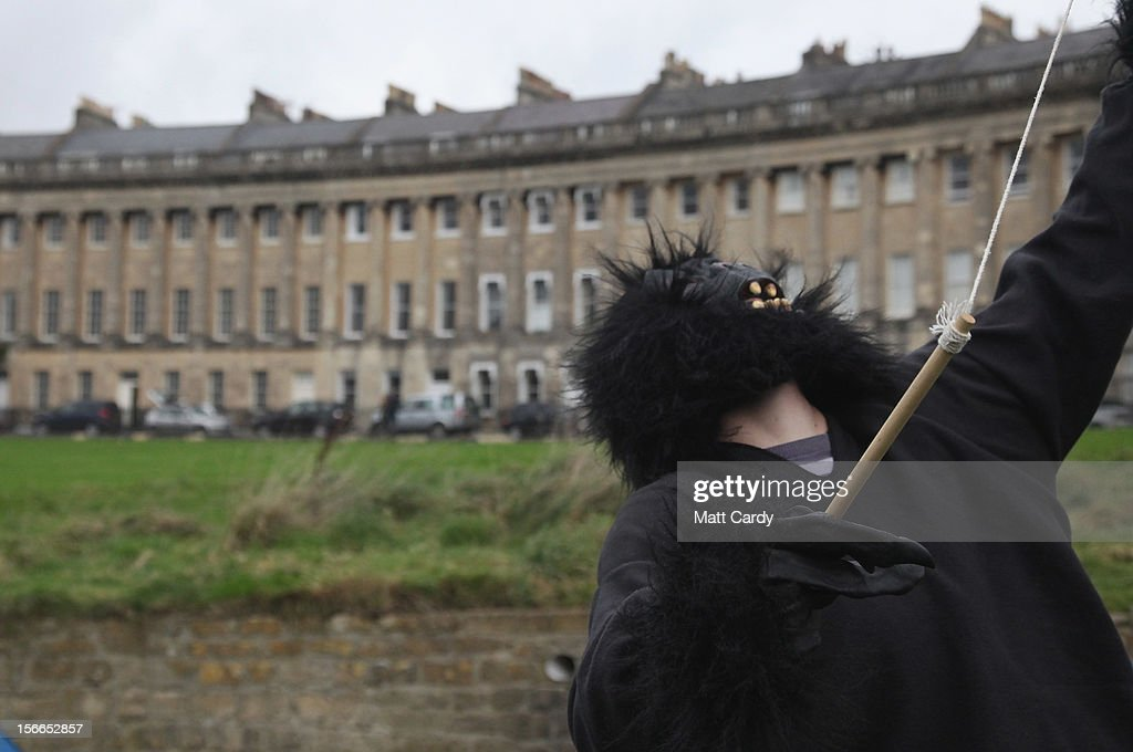 A campaigner from the Occupy Bath protest group, dressed in a gorilla costume, stands in front of Bath's Grade 1 Royal Crescent on November 17, 2012 in Bath, England. The small group of local representatives of the Occupy movement - which staged an occupation in the city for six weeks last year - moved into Royal Victoria Park in front of the historic landmark on Friday night, but claimed they would end the protest on Sunday.