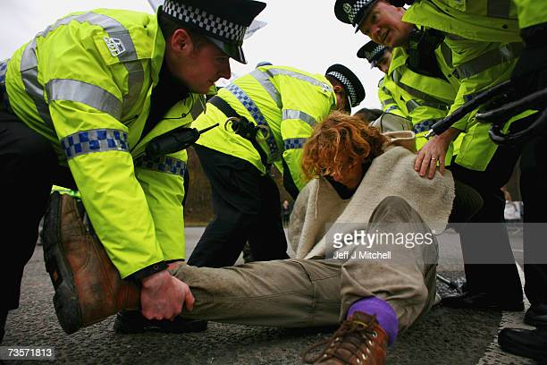 A campaigner is arrested during a protest at the Faslane naval base on the Clyde home of the Trident Submarine fleet March 14 2007 in Faslane...
