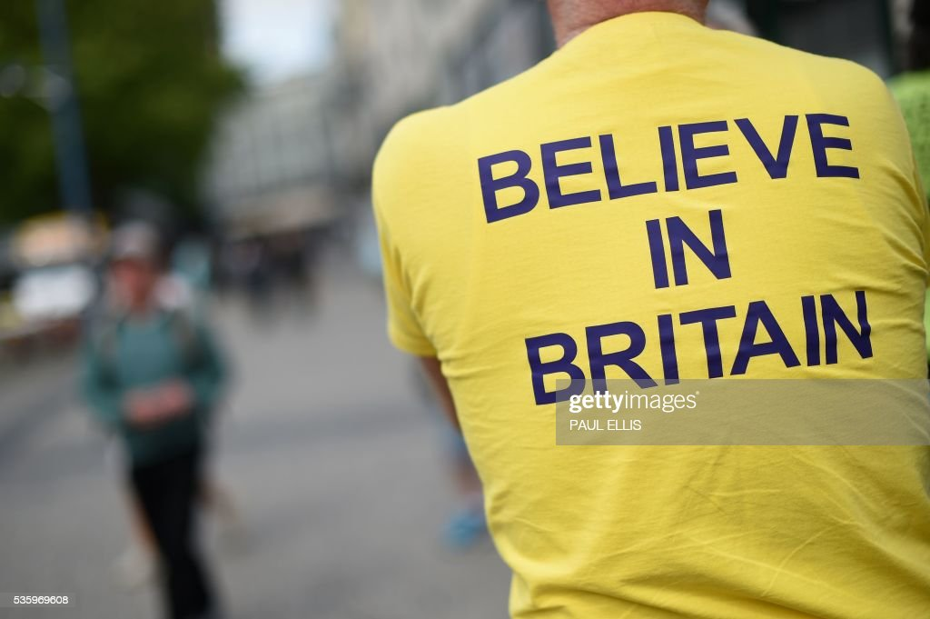 A campaigner wears a T-shirt bearing the slogan 'Believe In Britain' as he attends an Anti-EU (European Union) United Kingdom Independence Party (UKIP) pro-Brexit campaign event, ahead of the forthcoming referendum, in Birmingham, central England, on May 31, 2016. Politicians and world leaders have dominated the headlines in the campaign for Britain's Jun 23, 2016 EU referendum, but a passionate battle for the country's future is also being fought by activists on the streets. / AFP / PAUL