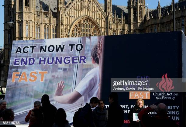 Campaigners and Church leaders assemble outside the Houses of Parliament in London alongside a giant billboard inviting the public to fast in...