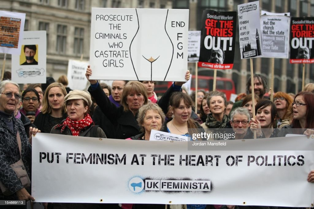 Campaigners attend a rally organised by UK Feminista to call for equal rights for men and women on October 24, 2012 in London, England. Hundreds of women from around the UK congregated in Westminster to attend a rally and lobby their local MPs to demonstrate against any legislation that damages women's rights.