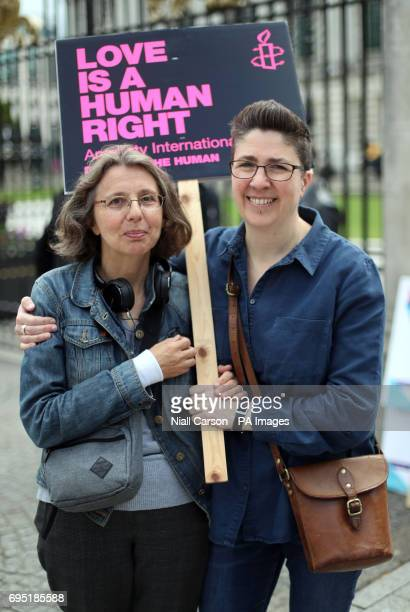 Campaigners Catherine Couvert and Sally Bridge from the Love Equality Coalition as they announce a march for Equal Marriage outside City Hall in...