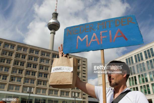 Campaigners demonstrate outside the new Primark store at Alexanderplatz on July 03 2014 in Berlin Germany The Irish fashion label has opened it's...