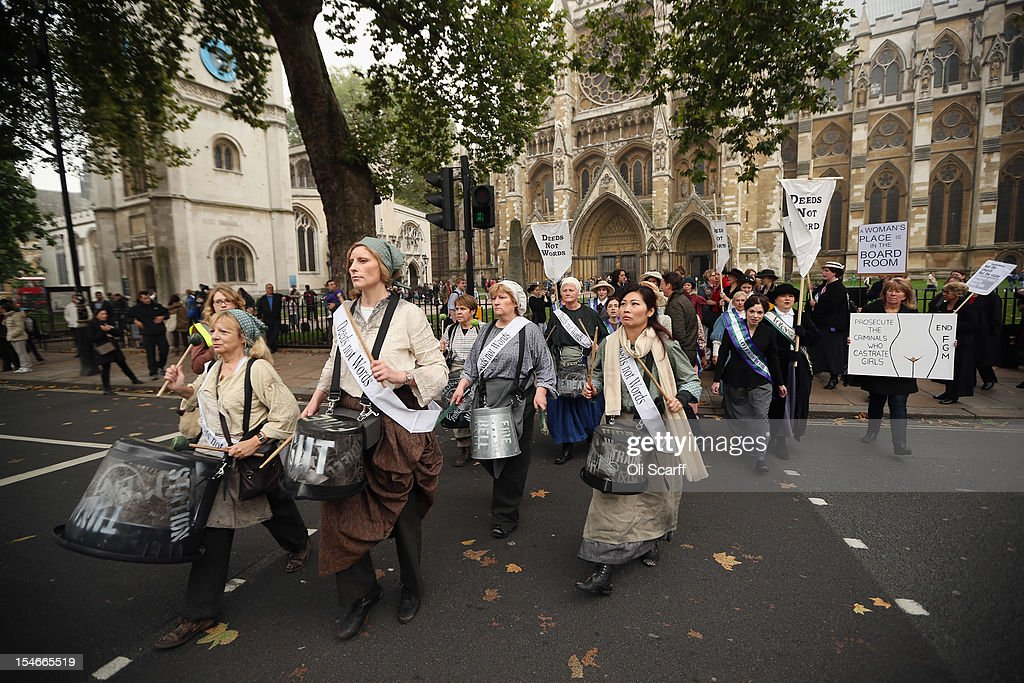 Campaigners dressed as suffragettes attend a rally organised by UK Feminista to call for equal rights for men and women on October 24, 2012 in London, England. Hundreds of women from around the UK congregated in Westminster to attend a rally and lobby their local MPs to demonstrate against any legislation that damages women's rights.
