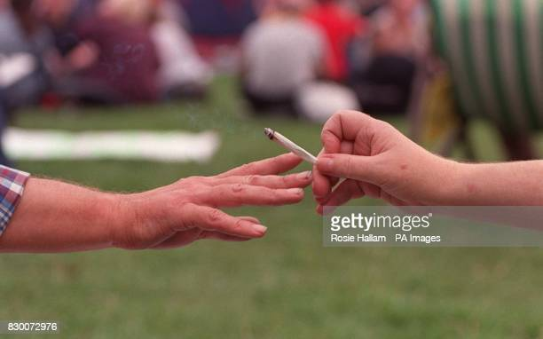 Campaigners for the legalisation of cannabis openly smoke the drug at a protest in central London 13/10/00 The RAC has said that legal driving limits...