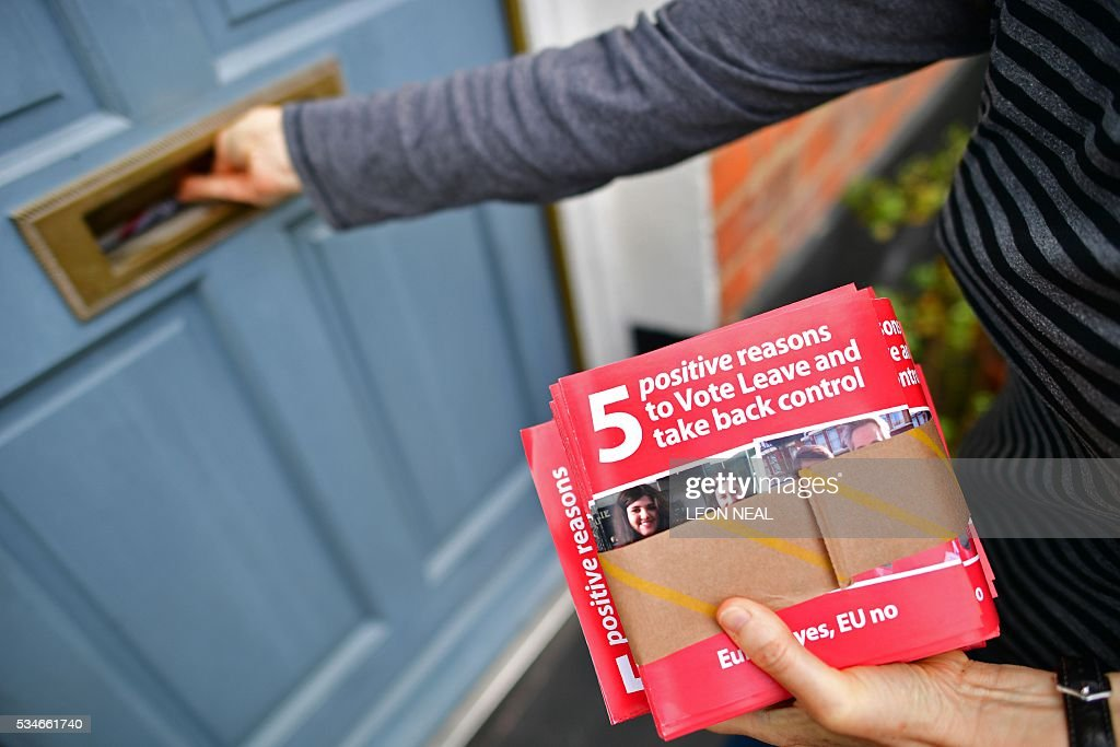 Campaigners for 'Vote Leave', the official 'Leave' campaign organisation for the forthcoming EU referendum, deliver leaflets to residents in north London on May 27, 2016. Campaigners for a 'Leave' vote in Britain's EU referendum launched an online competition and poll Friday offering £50 million for anyone who correctly predicts the outcome of every Euro 2016 fixture. The Vote Leave campaign said it had chosen the prize amount for the European football championships because it was equivalent to the sum that Britain contributes to the European Union budget every day. / AFP / LEON