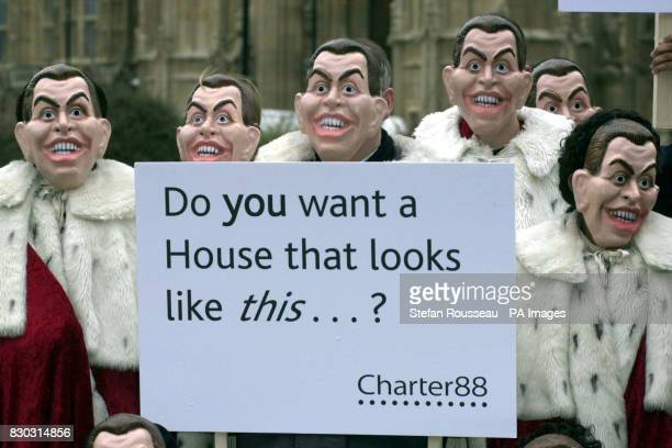 Campaigners from Charter 88 the organisation for constitutional reform wearing Tony Blair masks while protesting outside the House of Lords The Royal...