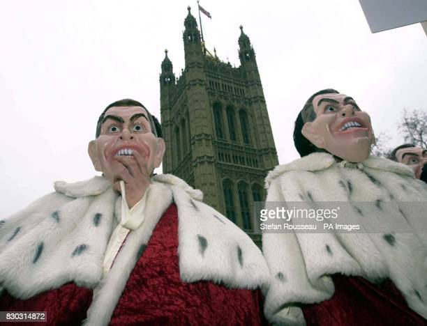 Campaigners from Charter 88 the organisation for constitutional reform wearing Tony Blair masks while protesting outside the House of Lords where The...